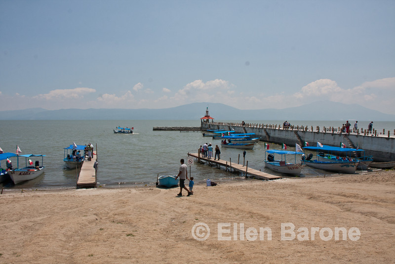 Beach scenic, tour boats at the pier, Lago de Chapala (Lake Chapala), Chapala Jalisco, Mexico.