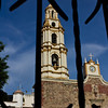 Catholic church, steeple and clock tower, as viewed through church gate, Ajijic, Jalisco, Mexico. Lago de Chapala (Lake Chapala)