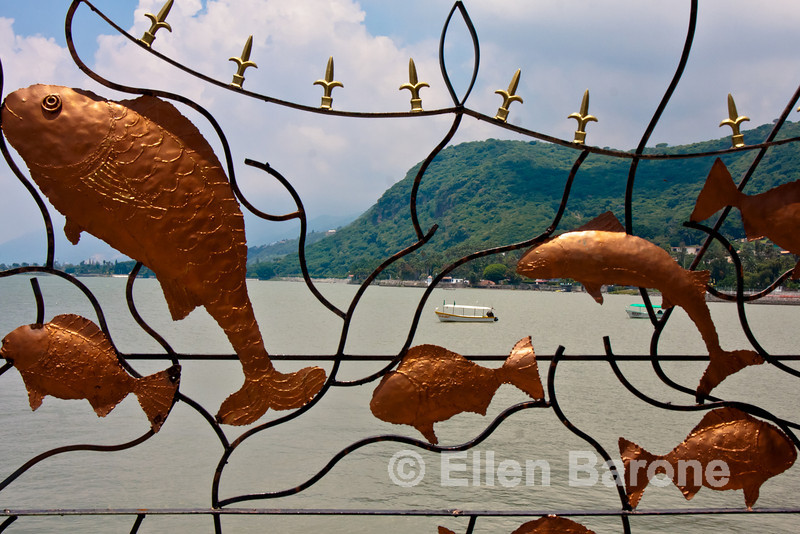 Lake and mountains as viewed through artistic gate, Lago de Chapala (Lake Chapala), Chapala, Jalisco, Mexico.