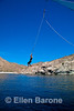 Safari Quest passenger Jason Mauro enjoys the ship's rope swing, Sea of Cortez, Baja California, Mexico.