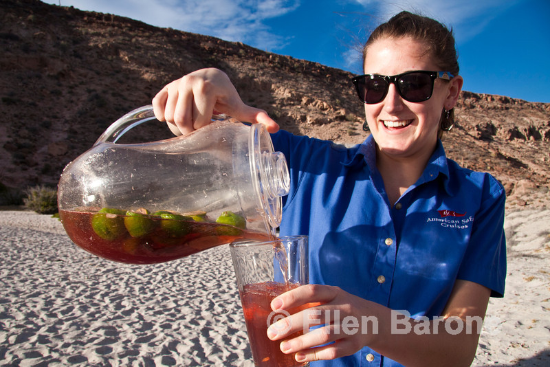 Safari Quest hotel manager, Sarah Weyerts, brings afternoon refreshment to the beach at Ensenada Grande, Sea of Cortez, Baja California, Mexico.