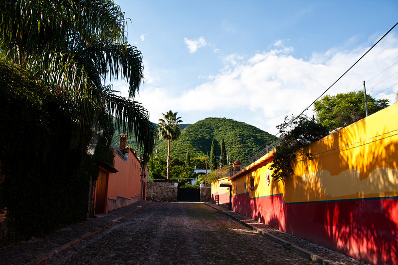 Cobblestone streets and mountain view, Ajijic, Jalisco, Mexico.