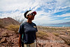 Expedition leader, Nitakuwa Barrett with Safari Quest in the distance, Isla Danzante, Sea of Cortez, Baja California, Mexico.