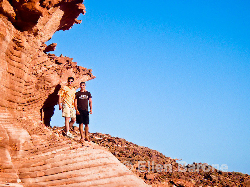 Safari Quest passengers Kirk and Jason Mauro among the scenic red sandstone at Puerto Los Gatos, Sea of Cortez, Baja California, Mexico.