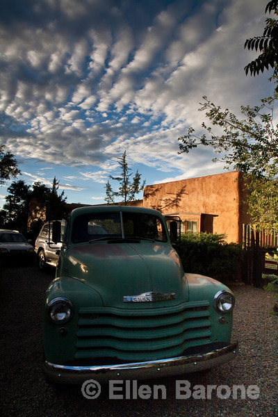 Dramatic sky, adobe building and classic truck, Canyon Road, Santa Fe, New Mexicog