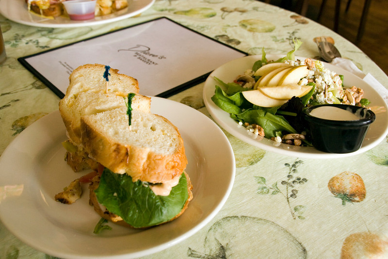 Southwest spicy grilled chicken and chile sandwich on homemade green chile cheddar bread with salad is a popular lunch order at Diane's Restaurant and Bakery, a local favorite in Silver City, New Mexico, USA.