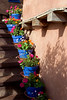 Blue flower pots on staircase, Canyon Road, Santa Fe, NM.