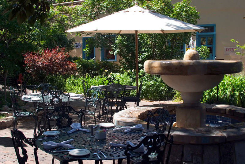Outdoor cafe tables and fountain, La Casa Sena restaurant, Sena Plaza, Santa Fe, NM