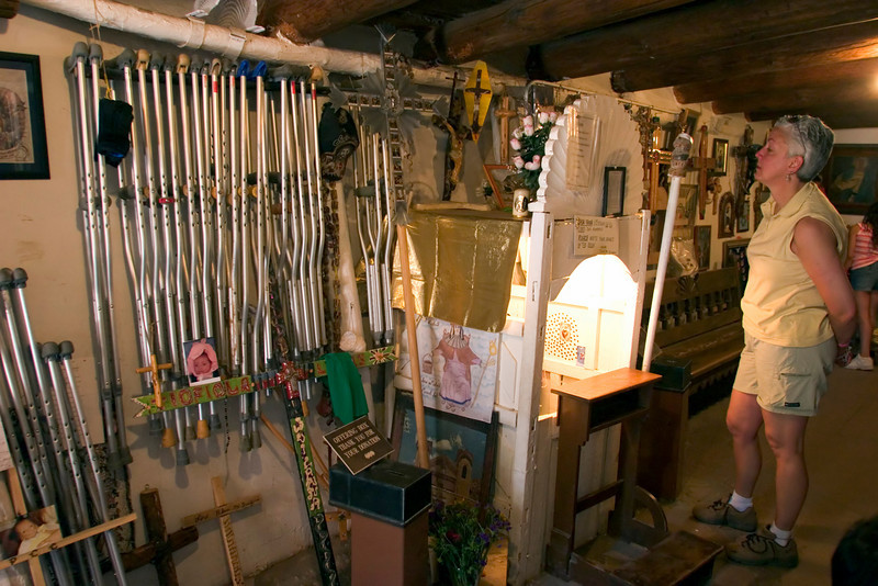 Testament to its healing powers, discarded crutches, braces and retablos fill the side rooms at Santuario de Chimayo, a place of reputed miracles, Chimayo, NM