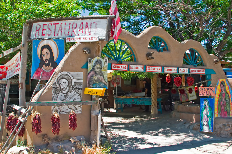 Religious icons surround the Santuario de Chimayo, a reputed place of miracles, Chimayo, NM (High Road to Taos)
