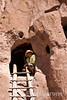 Wayfarer Ellen Barone, cliff dwellings, Bandelier National Monument, Jemez Mountains, New Mexico.
