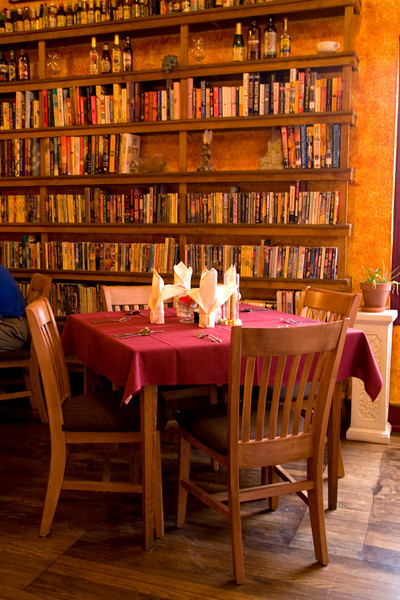 The books lining the walls at the popular restaurant Shevek & Mi are what remains of the property's former tenants - a used bookstore. Silver City, New Mexico, USA.