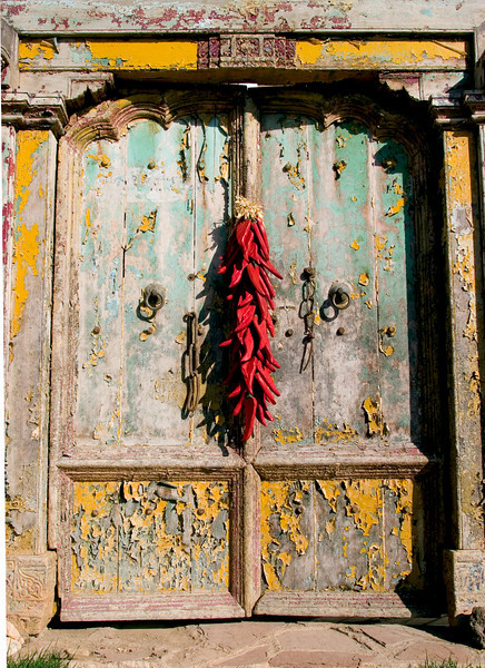 Wooden doorway with chile ristra, Antonio's Mexican restaurant, Taos, NM