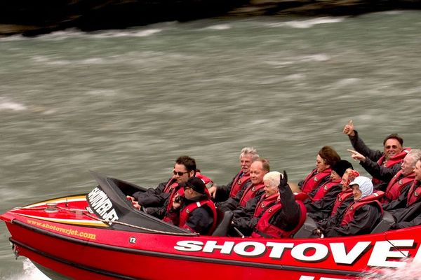 Collette vacationers and other tourists enjoy a thrilling Shotover Jetboat ride, Shotover River, Queenstown, South Island, New Zealand