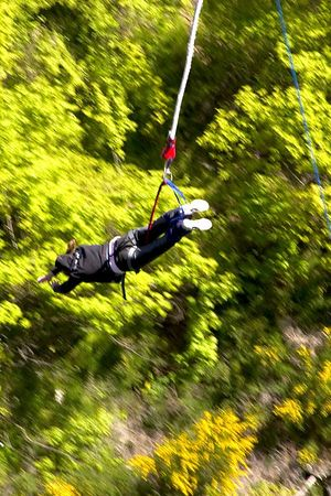 Collette vacationer Dr. Tony Nassif, bungy jumps off Kawarau bridge above the Kawarau river, Queenstown environs, South Island, New Zealand
