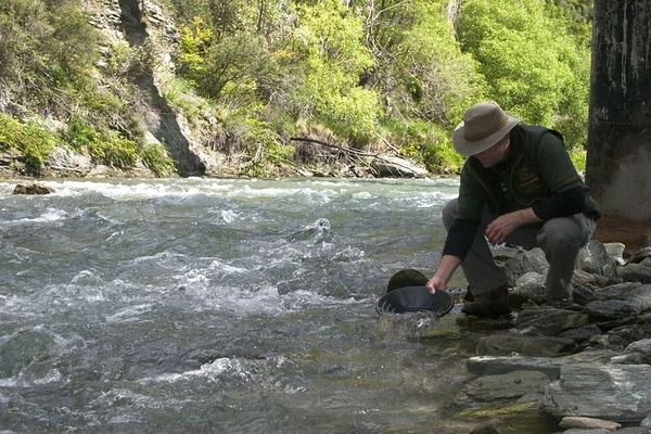 panning for gold in the Fox River, Arrowtown, South Island, New Zealand
