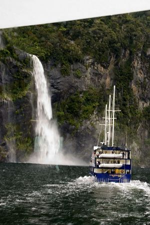 A boat cruise is the best way to experience the scenic beauty of Mildford Sound, Fjordland, South Island, New Zealand