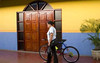 bicyclist, colorful wall, Masaya Arts & Crafts Market, Masaya, Nicaragua, Central America