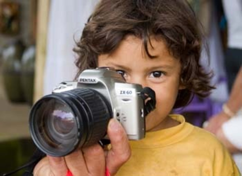 young girl with camera, Nicaragua, Central America