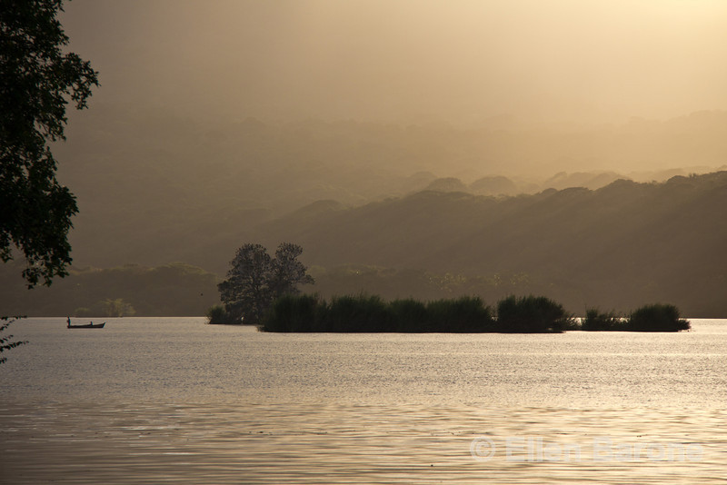 Local fishing boat in late afternoon rays of light, viewed from Jicaro Island Ecolodge, Lake Nicaragua.