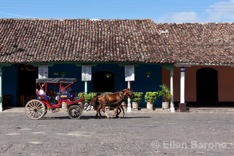 City scenes, slice of life, horse drawn carriage, Granada, Nicaragua.