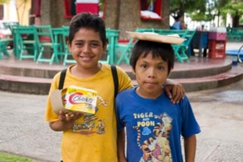 young boys selling on the plaza, Granada, Nicaragua, Central America