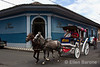 Horse-drawn carriage passes by hotel entrance, Hotel la Bocona, an intimate six guest room boutique hotel in a restored colonial mansion in Granada, Nicaragua.