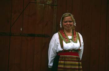 Costumed interpreters are available to answer questions at Skansen, an open-air folk museum in Stockholm, Sweden