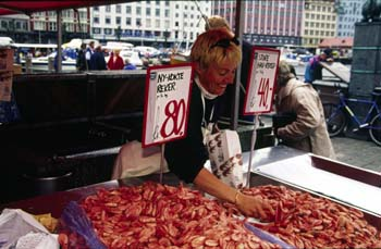 Selling fish in Torget, the city's famous fish market, Bergen, Norway