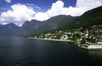 Charming coastal villages hug the fjord hillsides in Norway's west coast.