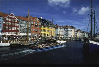 One of the nicest ways to get a first feel for the city is from the water aboard a canal boat, Copenhagen, Denmark
