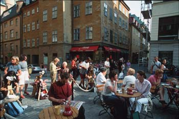 Outdoor cafes line the square at Stortoget at the heart of Gamla Stan (Old Town), Stockholm, Sweden