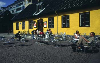 Cafes spill out onto the pavement in summer, Oslo, Norway