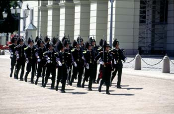 Changing of the guards ceremony occurs daily at Det Kongelige Slottet (Royal Palace), Oslo, Norway