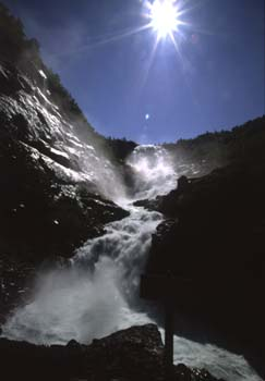 The torrent of Kjosfossenen waterfall, one of many beautiful falls along the famous Flam Train route, Norway
