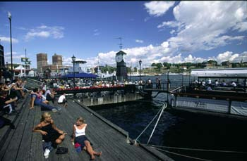 Aker Brygge (Aker Docks) bustles with life during the summer months, Oslo, Norway