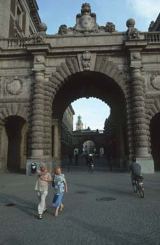 The cobbled pedestrian shopping street Drottninggatan leads to the Gamla Stan, the old town of Stockholm, Sweden