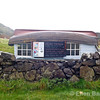Wee shed and rural advertisement at Calgary beach, Isle of Mull, Scotland, U.K.