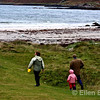 Family with dog at Calgary beach, Isle of Mull, Scotland, U.K.