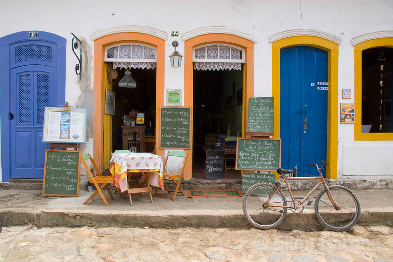 Colorful cafes and shops line the cobbled streets of picturesque Parati, a colonial UNESCO World Heritage community, Brasil. ©2007 Ellen Barone.