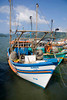 Colorful fishing boats line the cais do porto (pier) in colonial Parati, a UNESCO World Heritage community, Brasil. ©2007 Ellen Barone.