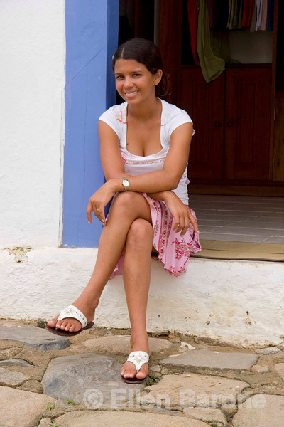 A lovely shop girl in doorway, picturesque Parati, a colonial UNESCO World Heritage community, Brasil. ©2007 Ellen Barone.