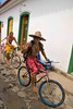 Friendly bicyclists in the historic auto-free zone of colonial Parati, a UNESCO World Heritage community, Brasil. ©2007 Ellen Barone.