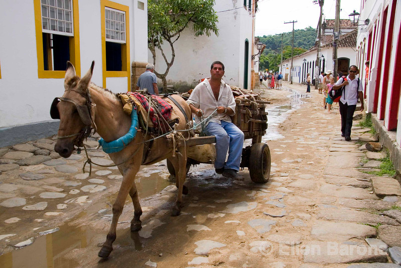 Automobiles are banned from the historic district, where a junkman's horse and cart lumbers across the cobblestones in colonial Parati, a UNESCO World Heritage Site community, Brasil. ©2007 Ellen Barone