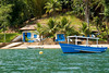 Colorful coastal scene, boat house and boat, near Parati, Brasil. ©2007 Ellen Barone.