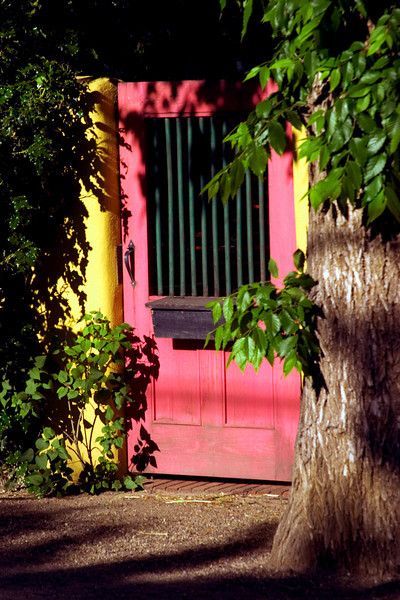 Colorful wooden gate in late afternoon light, Santa Fe, NM