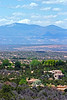 City overview and Sangre de Cristo mountains, as viewed from Dale Ball hiking and mountain bike trails, Santa Fe, New Mexico, USA.