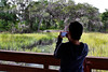 Tourist photographing with iPhone, Coastal Discovery Museum at Honey Horn, Hilton Head Island, South Carolina, USA, North America.