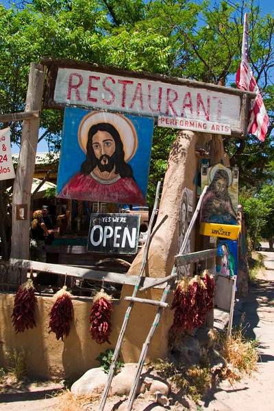 Religious signage surrounds the Santuario de Chimayo, a place of many reputed miracles, Chimayo, NM (High Road to Taos)