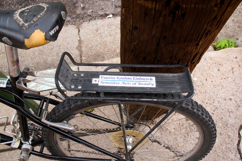 "Bicycle bumper sticker ""Practice Random Acts of Kindness and Senseless Acts of Beauty"" reflect the small town friendliness of Silver City, New Mexico, USA"